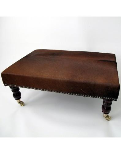 Large plain dark brown cowhide footstool 202 with turned dark leg